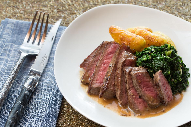 apron steaks au poivre with crispy fingerling potatoes sauteed kale