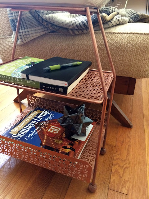 Give a Mid-Century Modern magazine rack new life with a coat of metallic spray paint!
