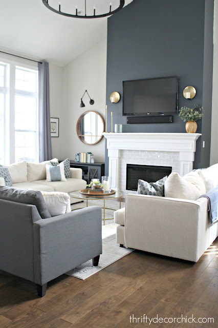 Dark fireplace wall in Cyberspace with white surround and light gray tile