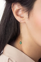 Long gold threader earrings with emerald drops