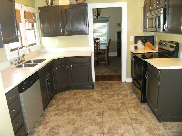 Kitchen remodel, painted cabinets, Olympic phantom mist, corian counter top, 18 x 18 peel and stick tile
