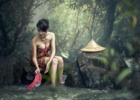 Am Asian lady taking a bath.