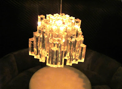 Close up of a modern dolls' house miniature 1970s-style chandelier.