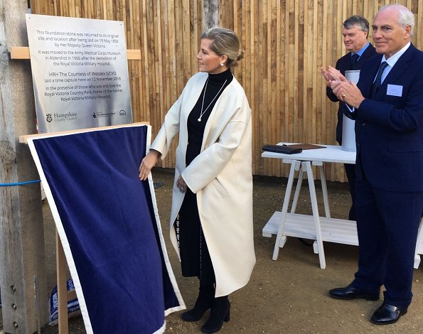 Countess of Wessex wore Prada wool coat and Victoria Beckham Tweed side drape midi skirt for visit Netley Hospital