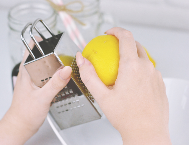 Removing zest from lemon using cheese grater