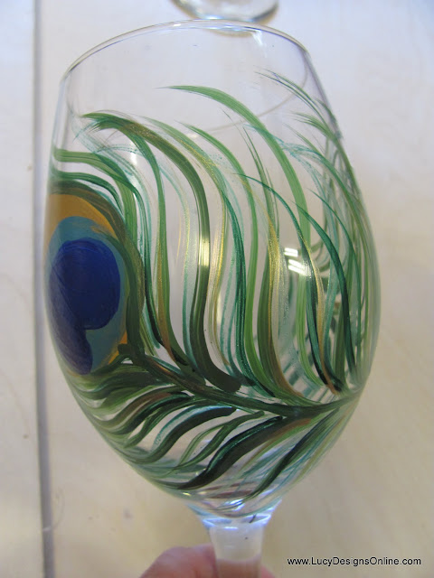 hand painted peacock feather on wine glass using glass paints