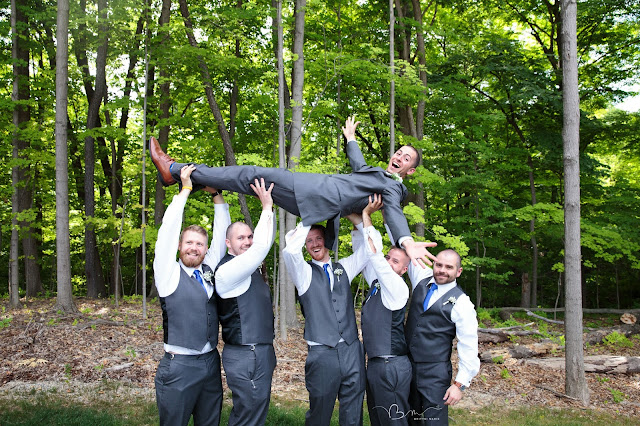 groomsmen lifting groom at Noah's Event Venue in Auburn Hills Michigan