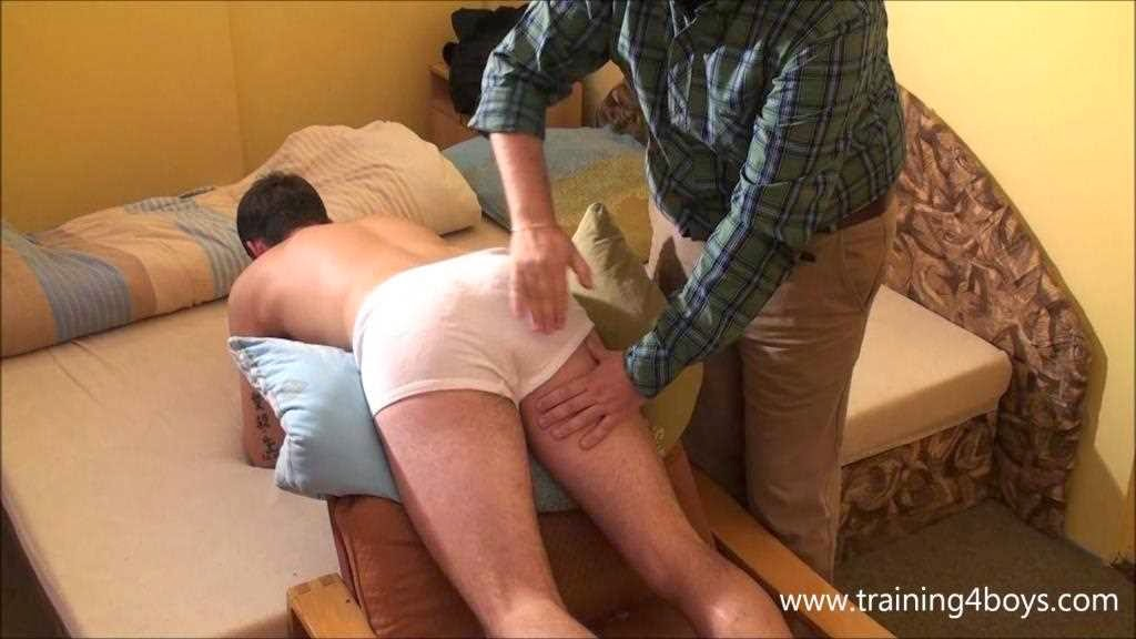 Men spank boys in underpants