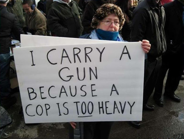 Funny woman gun protest sign picture - I carry a gun because a cop is too heavy