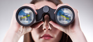 A woman is looking through binoculars with graphs reflected in each lens