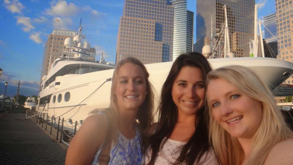 us in front fancy yacht in New York