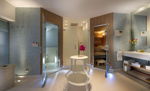 Large modern bathroom with separated shower cabin and toilet