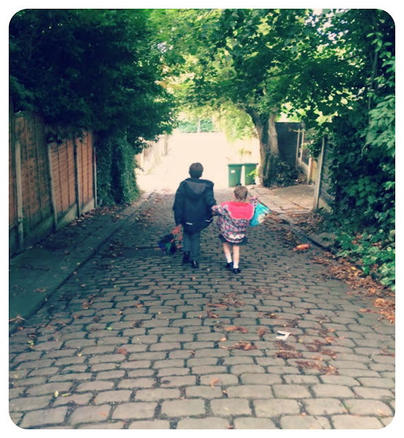 two children walking to school