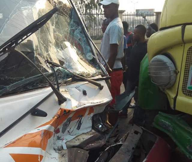 Photos: Passengers escape death as bus rams into truck in Anambra