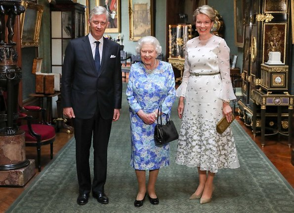 King Philippe and Queen Mathilde met with Queen Elizabeth II at Windsor Castle.Belgian Remembrance Parade. Queen wore Natan dress