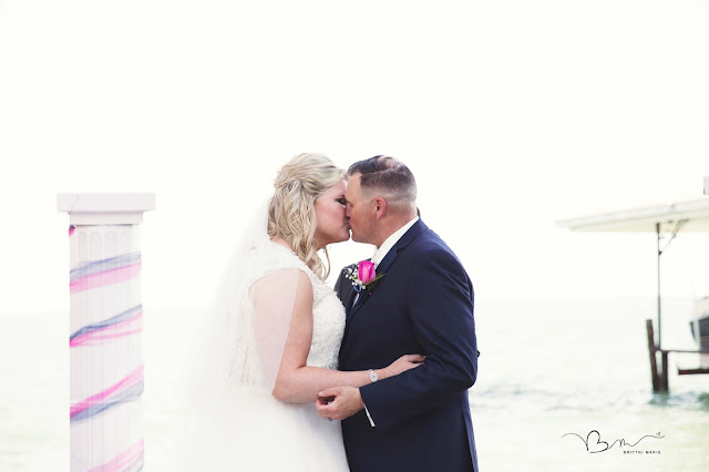 first kiss at new baltimore waterfront wedding