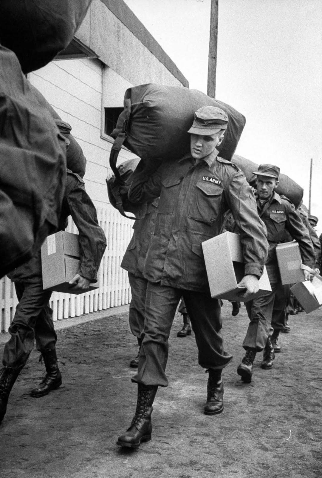 Presley clad in Army fatigues.