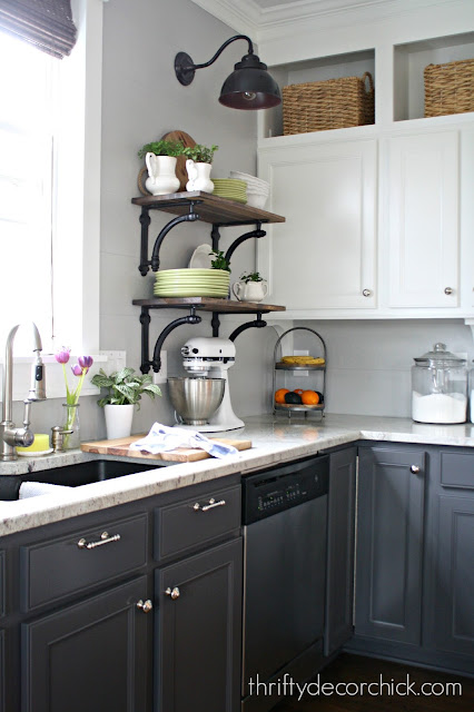 Dark gray base cabinets and white uppers