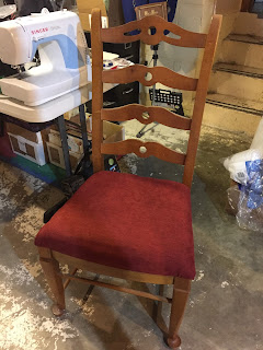 Dining room chair with new padding and cover.