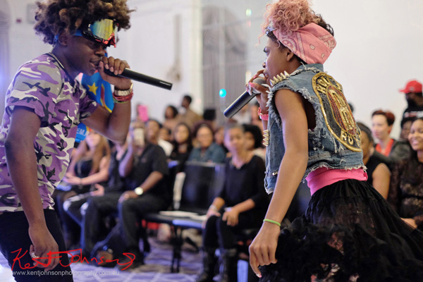 Singing to each other, King Imprint & Kandi Reign Dance It Up LIVE at NYFW - Photographed by Kent Johnson for Street Fashion Sydney.
