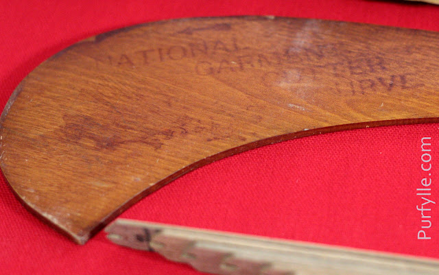 National Garment Cutter curved instrument with the title printed on the other side