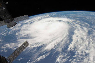 A new analysis of global hurricane data since 1980 shows the number of storms with winds over 124 mph has doubled, and those with winds over 155 mph has tripled. (Credit: NASA) Click to Enlarge.