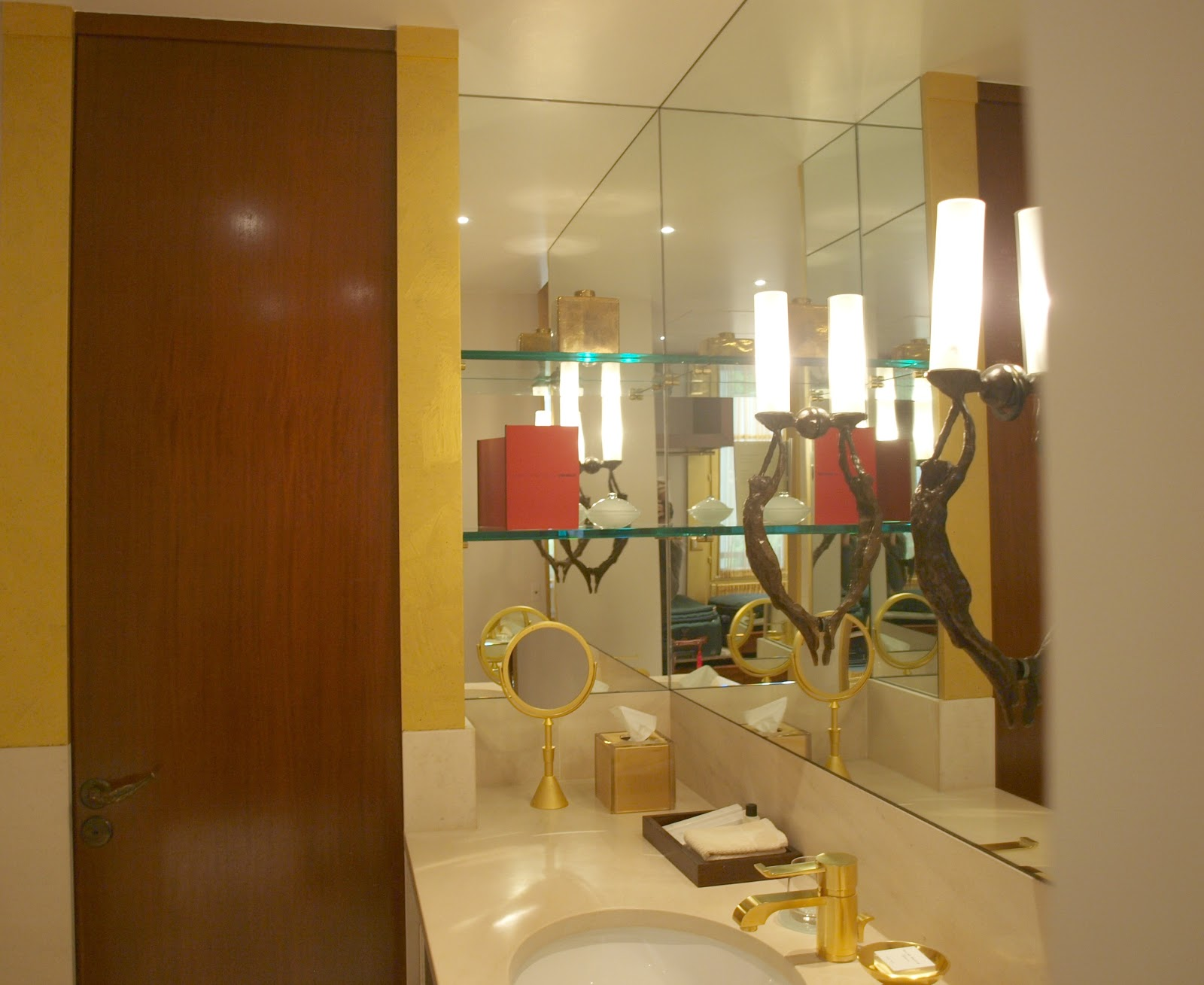 Elegant gold and mahogany bathroom in Park Hyatt Paris Vendome - by Hello Lovely Studio
