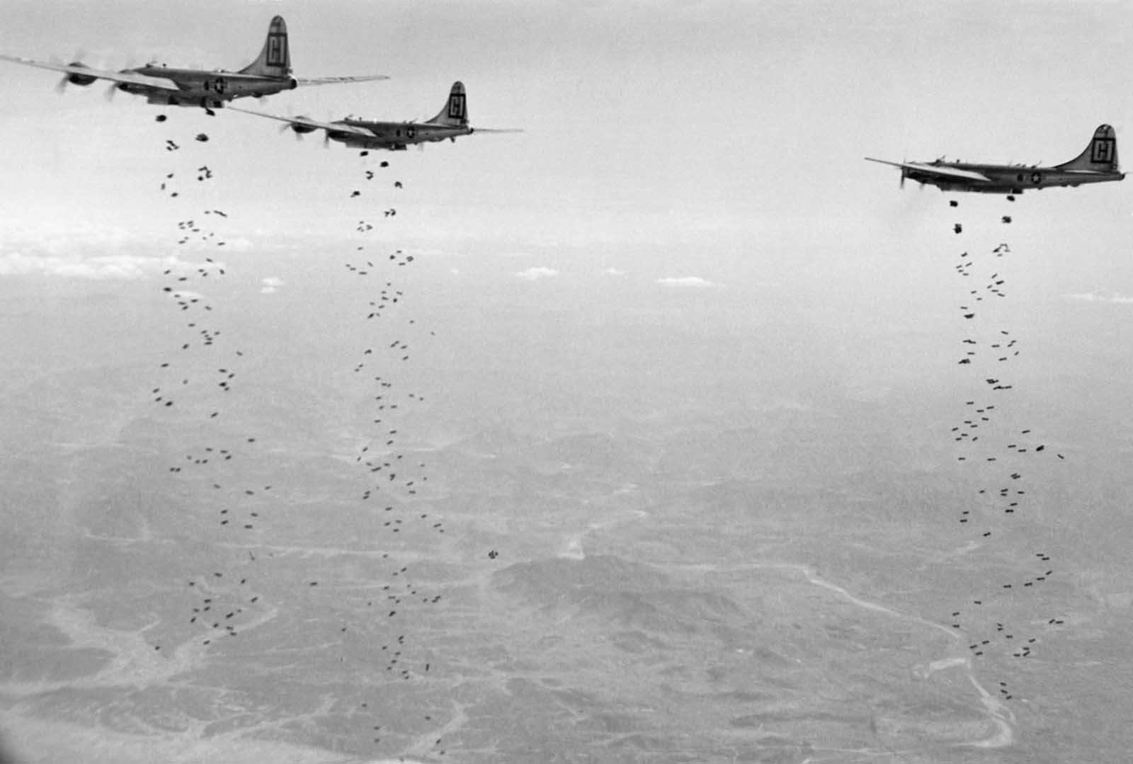 Bomber Command planes of the U.S. Far East Air Forces rain tons of high demolition bombs on a strategic military target of the Chinese Communists in North Korea on January 18, 1951.