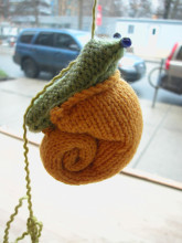 https://torontoknitcafe.wordpress.com/2012/04/01/at-a-snails-pace/