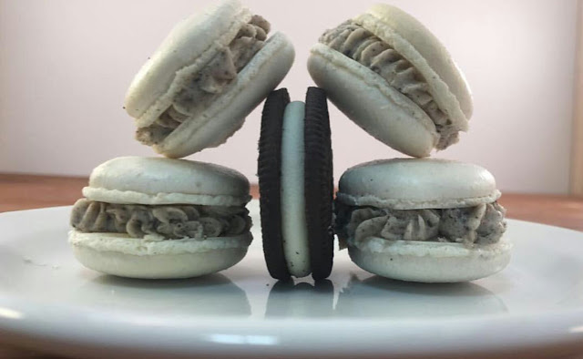 Cookies & Cream Macarons on a white plate with an oreo in the middle