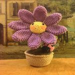http://www.ravelry.com/patterns/library/daisy-flower-with-ladybug-2