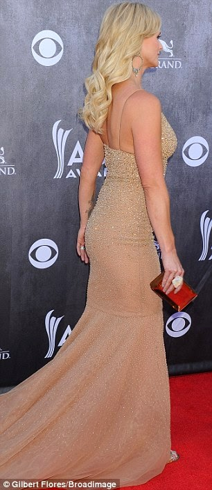 1a79add76db There was probably a long reaction to the gown by the press photographers  when quite possibly every single jaw just dropped. Miranda makes that  happen in a ...