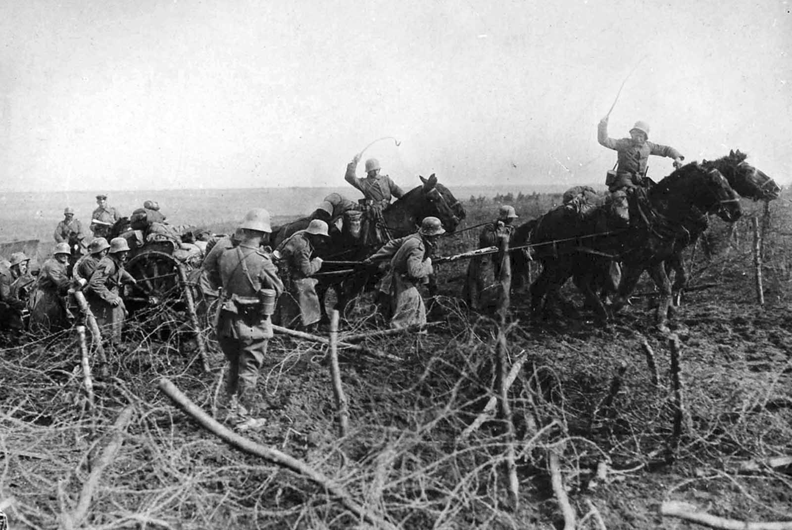 The breakthrough west of St. Quentin, Aisne, France. Artillery drawn by horses advances through captured British positions on March 26, 1918.