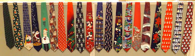 Picture of a row of Christmas ties hanging on a cubicle wall