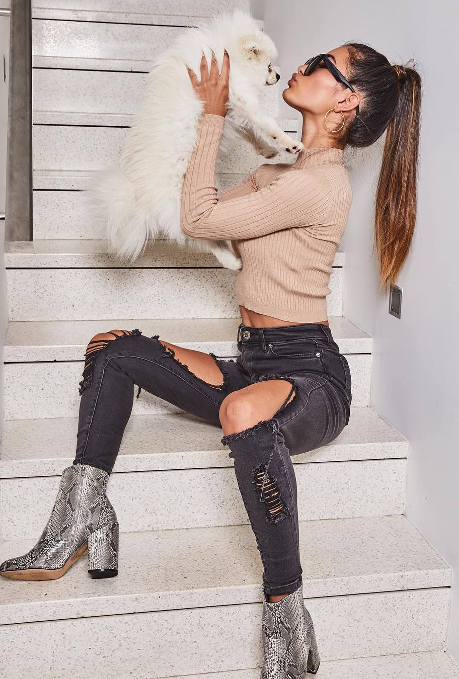 how to style a pair of snake boots : beige top and black distressed jeans