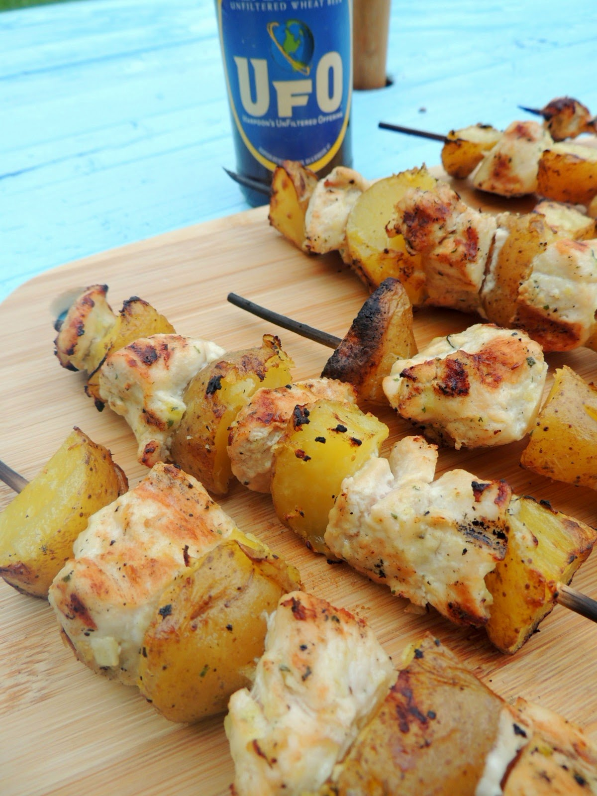 Juicy chunks of chicken and hearty potatoes are marinated in a simple 4 ingredient marinade, skewered, and then grilled to perfection in these Beer & Ranch Chicken & Potato Kabobs.