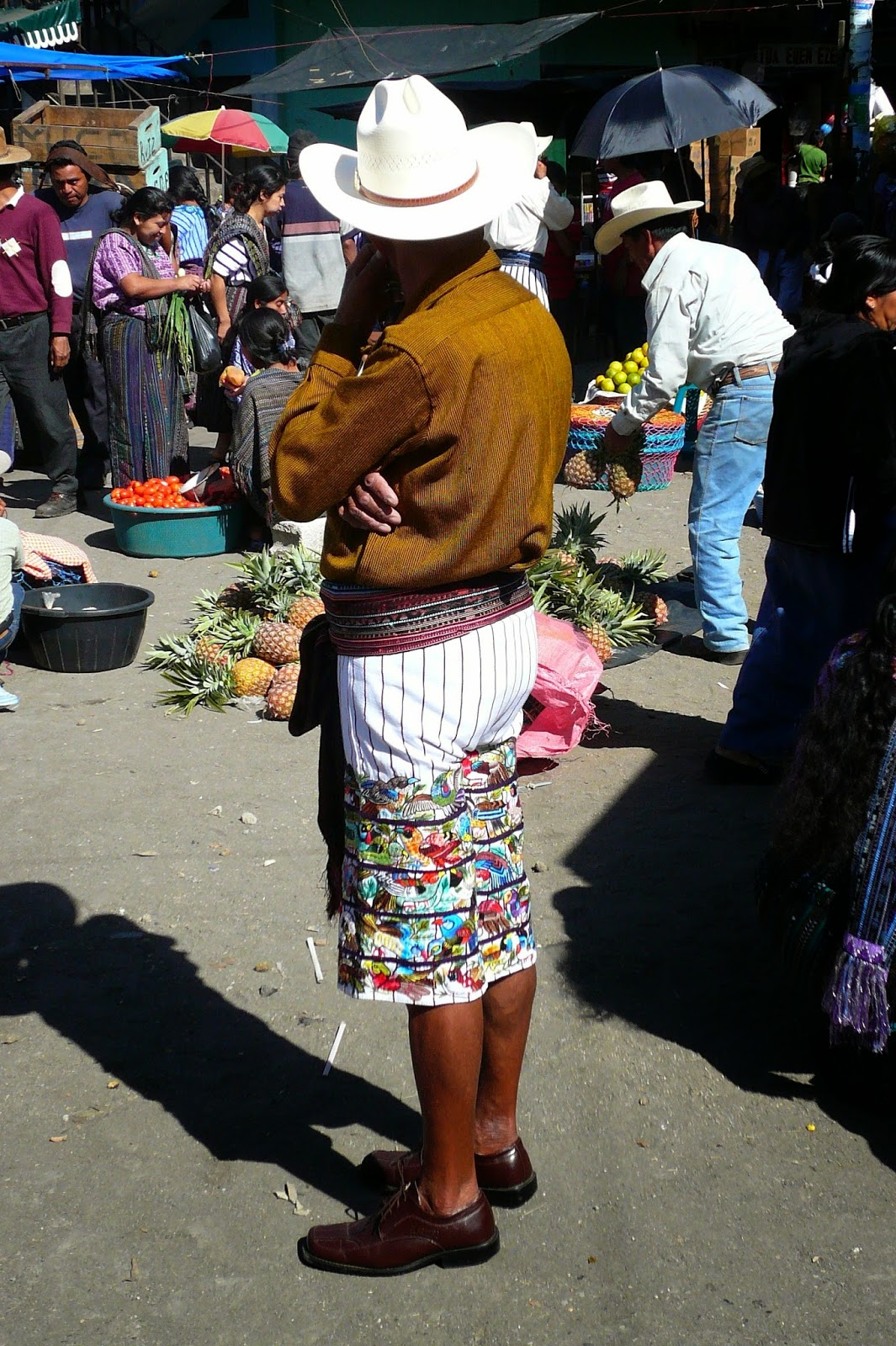 Man from Santiago Atitlan wearing traditional embroidered pants
