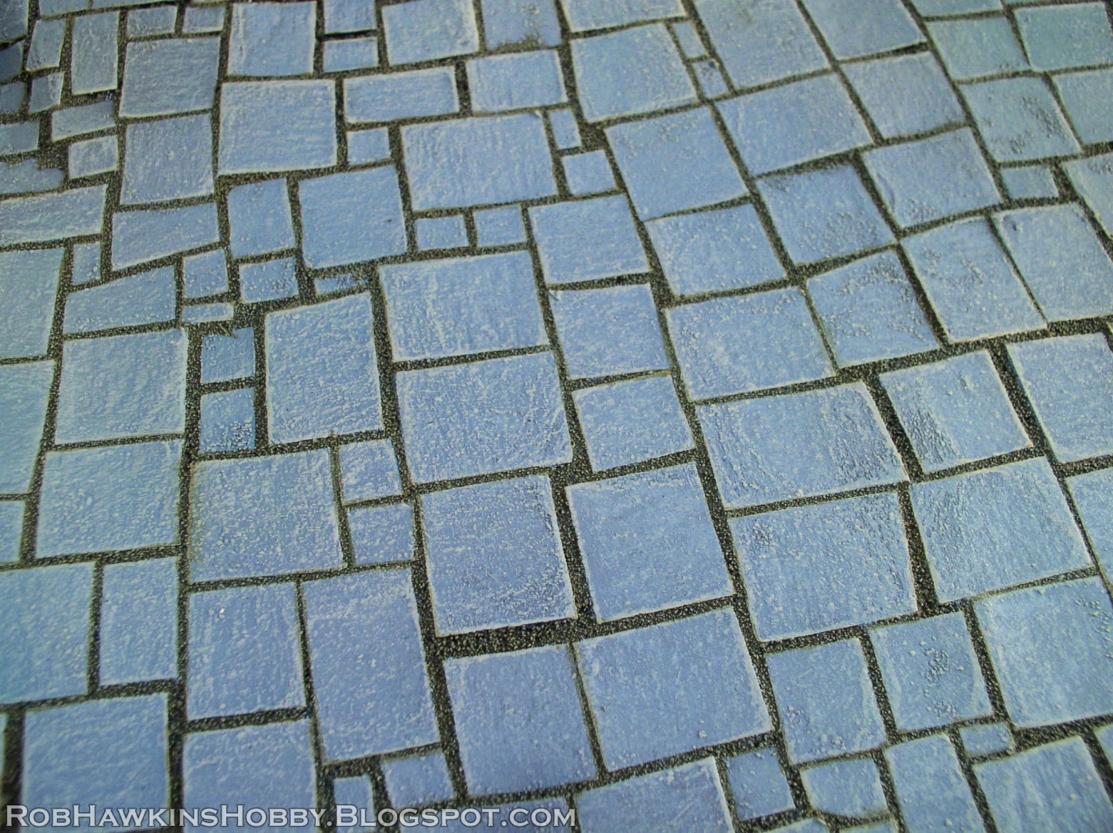 http://robhawkinshobby.blogspot.com/2014/07/terrain-tutorial-flagstone-streets.html