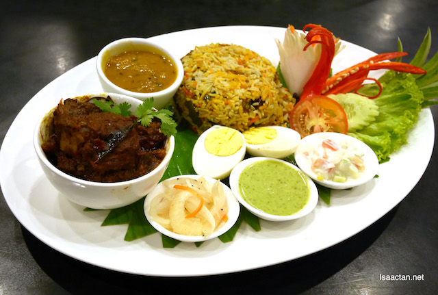 Legendary Lamb Briyani served with condiments