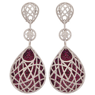Intricate Earrings curated in 18 K Gold finished in black polished tone and studded with Rubies inside a net of fine-cut diamonds by Tanya Rastogi