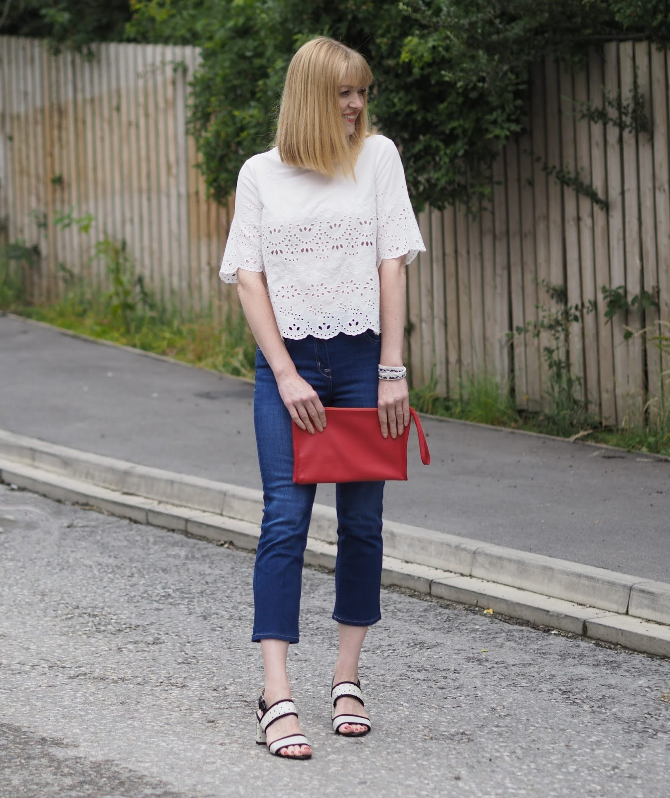 White Marks and Spencer broderie top, cropped flared jeans, back and white spotted sandals
