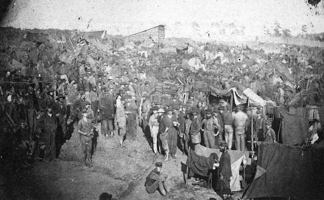 Union prisoners draw their rations in this view from main gate of Andersonville Prison, Georgia, on August 17, 1864.
