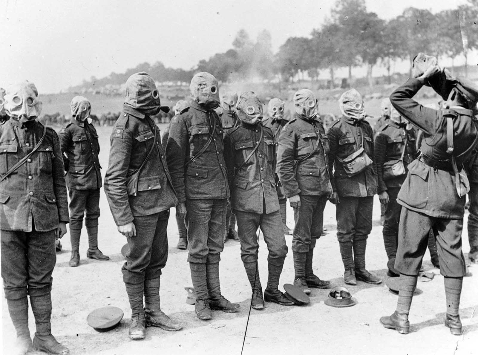 Irish Guards line up for a gas mask drill on the Somme, in September of 1916.