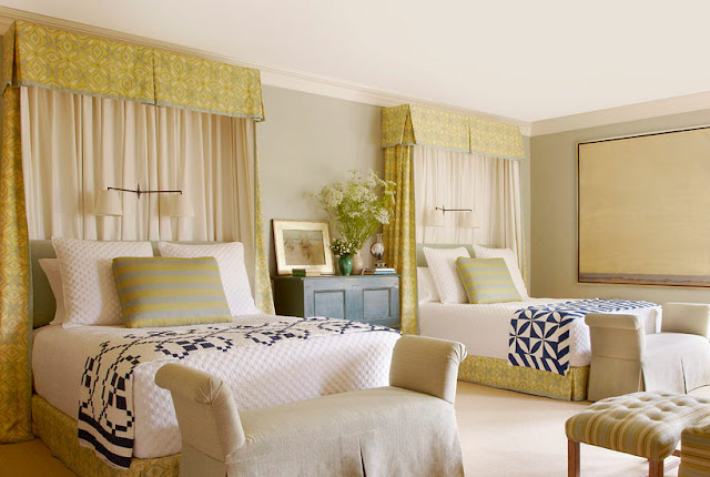 Bedroom with blue and white quilts in Meadowmere Southampton home by Carrier and Company