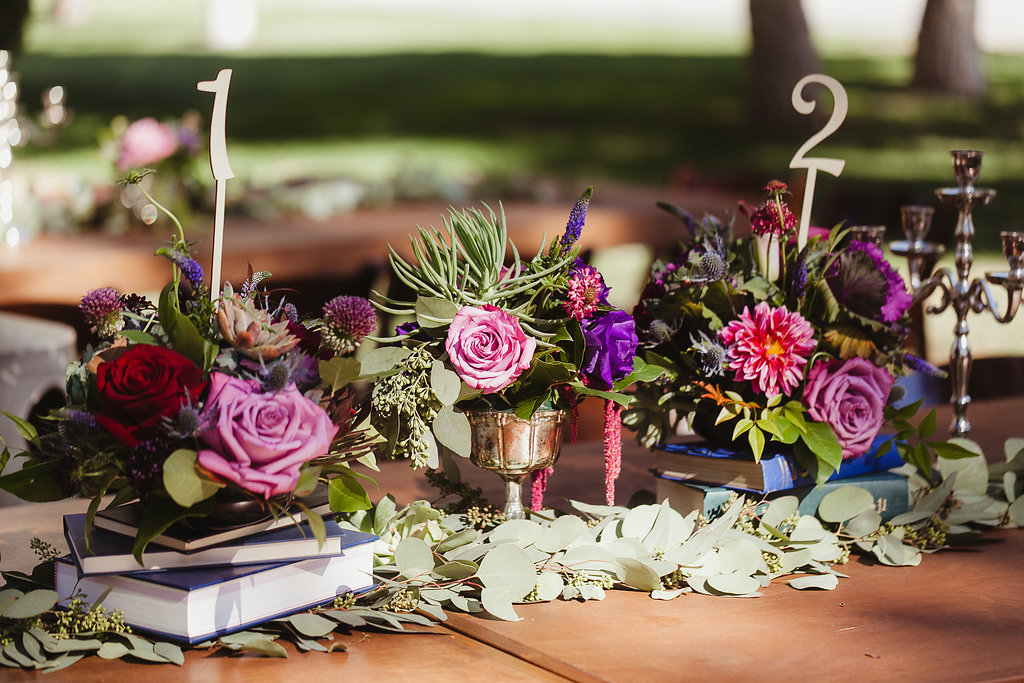 Loving The Table Decor We Used All Blue Books With Flower Atopnatural Setting Feeling Nature
