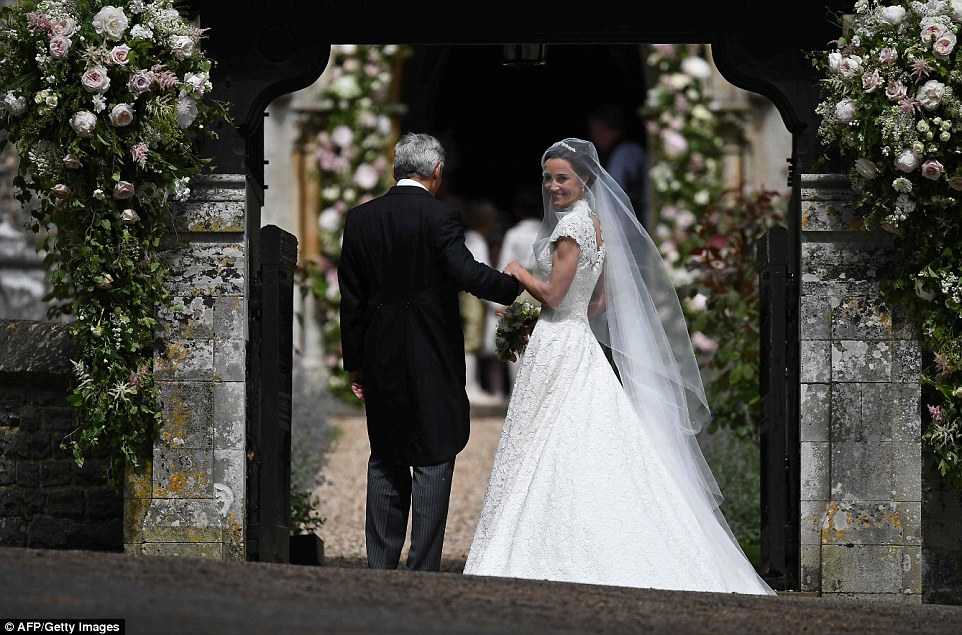 Pippa Middleton stunned in a slinky white gown by British couturier Giles Deacon