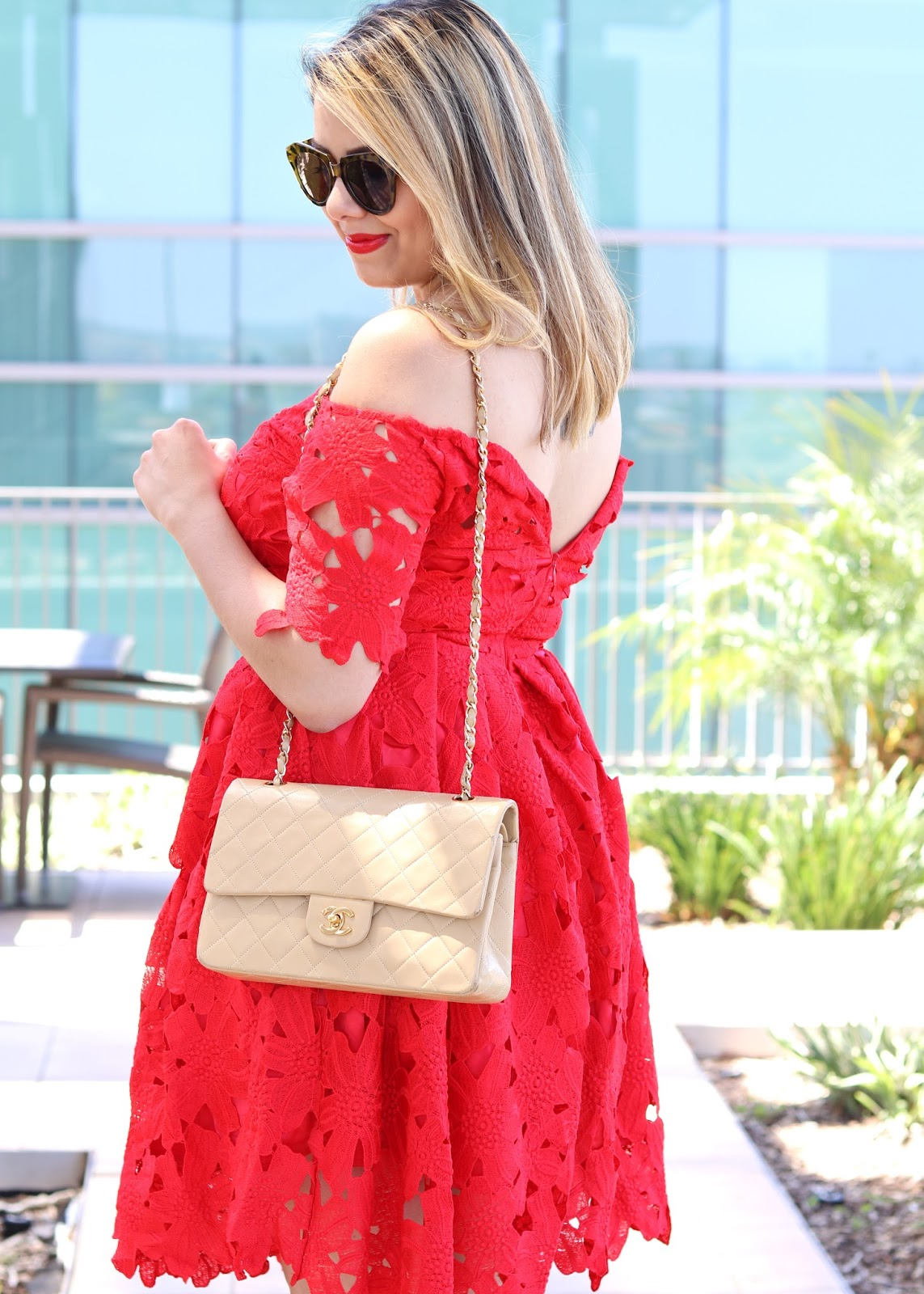 how to look elegant, classic chanel flap bag, consigned chanel purse, off the shoulder dress, off the shoulder red dress, off the shoulder cocktail dress