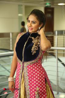 Telugu Actress Sri Reddy Mallidi Stills in White Beautiful Dress at Marriage Needs Bridal Fashion Week 2017 Logo Launch  0070.JPG