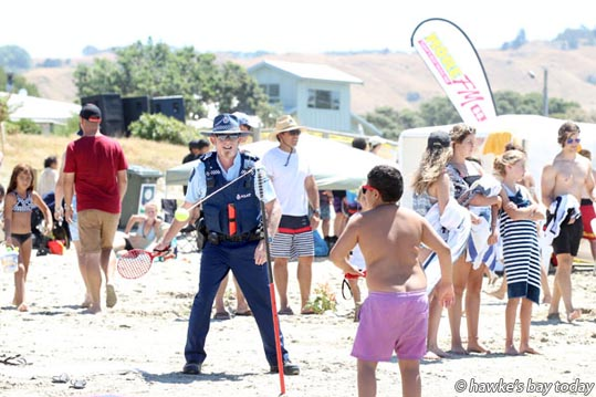 Sergeant Cory Ubels, serious crash unit, Hawke's Bay Police, playing swingball at Waimarama Beach Day, a MoreFM fundraiser for Waimarama Surf Lifesaving at Waimarama Beach, Waimarama. photograph