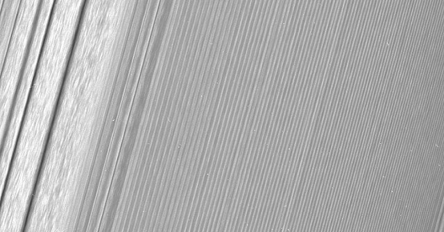 "This Cassini image features a density wave in Saturn's A ring (at left) that lies around 134,500 km from Saturn. Density waves are accumulations of particles at certain distances from the planet. This feature is filled with clumpy perturbations, which researchers informally refer to as ""straw."" The wave itself is created by the gravity of the moons Janus and Epimetheus, which share the same orbit around Saturn. Elsewhere, the scene is dominated by ""wakes"" from a recent pass of the ring moon Pan. Credits: NASA/JPL-Caltech/Space Science Institute"